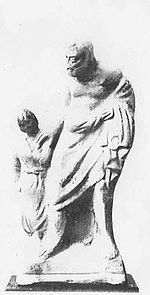 An ancient Greek statue of the slave Pedagogue (Wikipedia)