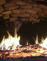 Image of wood-fired oven courtesy of Vinny Burgoo on Wikipedia